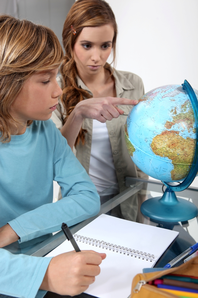 Baby Sitter points to a Globe while tutoring a child